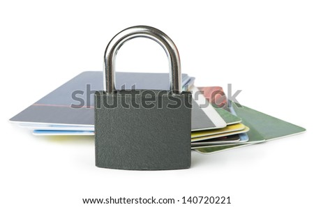 Grey locked padlock and credit cards. Isolated studio shot.