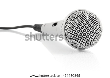 grey metallic microphone with cable isolated on white background - stock photo