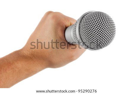 grey microphone in hand isolated on white background - stock photo