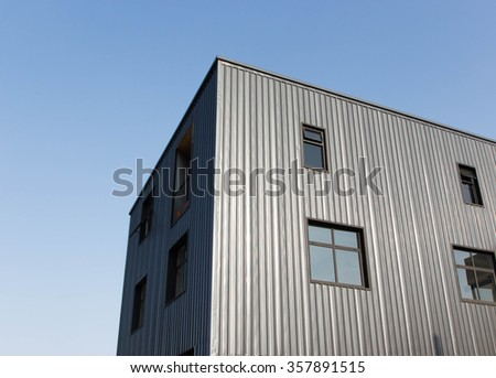 grey modern building with blue sky