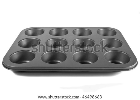 Grey muffin pan isolated on a white background - stock photo
