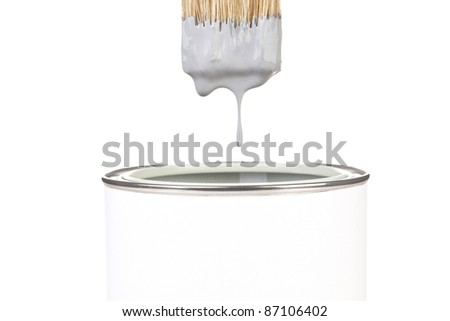 Grey paint dropping from brush into can isolated on white background. DIY creativity concept. - stock photo