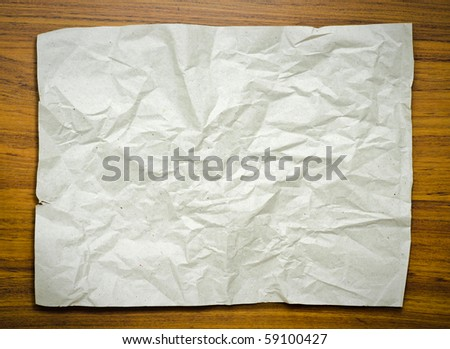 Grey paper on wood floor - stock photo