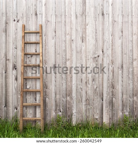 grey plank wall with wooden ladder background - stock photo