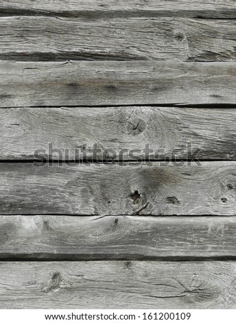Grey planks with varying surfaces placed horizontally. - stock photo