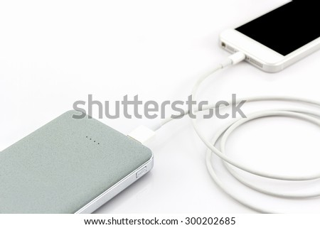 Grey power bank USB cable for smartphone on white background. - stock photo