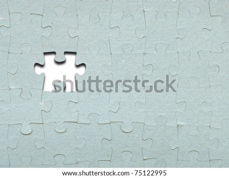 Grey puzzle with missing piece - stock photo