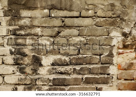 Grey Red Black Old Damaged Brick Wall Background Texture Close-up - stock photo