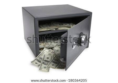 Grey safe with American dollar bills spilling out on white background - stock photo