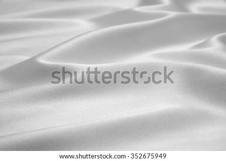 Grey satin fabric as background - stock photo