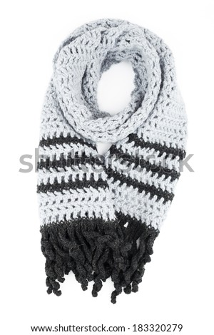grey scarf of handwork knitted by a hook on a white background - stock photo