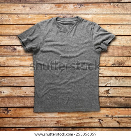 Grey shirt over wood background - stock photo