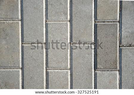 Grey sidewalk tile top view - stock photo