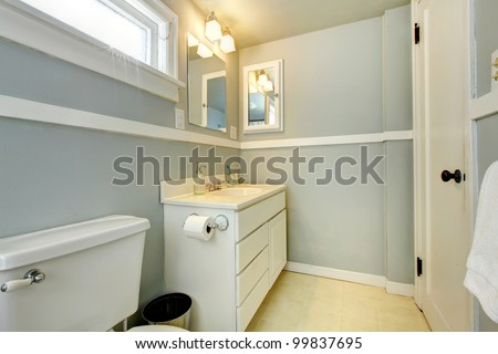 Grey simple bedroom with white cabinet and white door. - stock photo