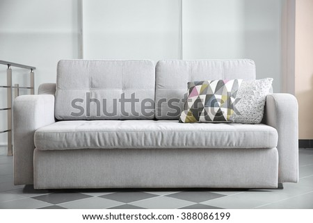 Grey sofa in the room, close up - stock photo