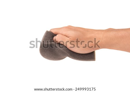 Grey Sponge for cleaning and polishing  in hand on White Isolated background - stock photo