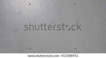 Grey steel diamond plate useful as a background - stock photo