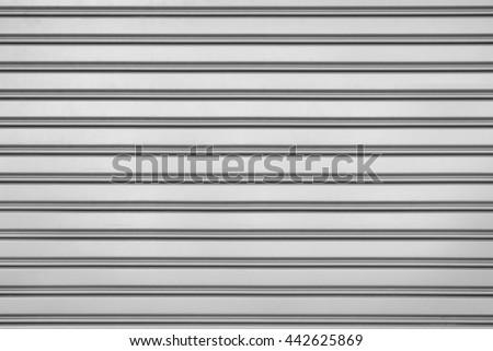Grey steel door with horizontal lines background. - stock photo