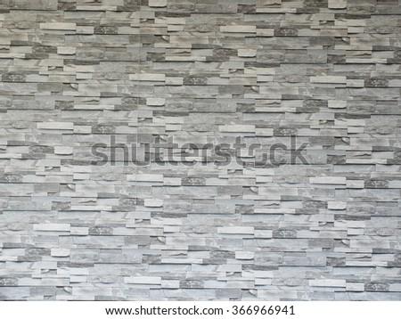 Grey stone tile wall pattern. - stock photo