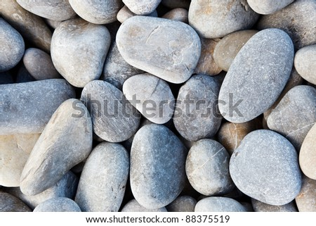 Grey stones captured in sunlight making beautiful background - stock photo