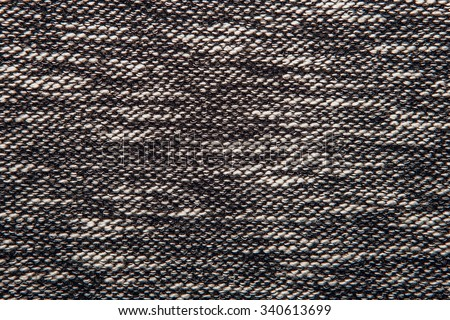 Grey tweed like texture, gray wool pattern, textured salt and pepper style black and white melange upholstery. Fabric background copy space - stock photo