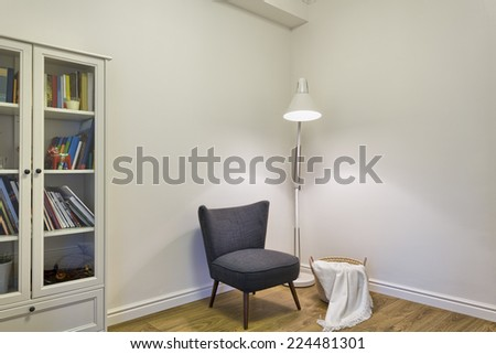 Grey upholstered chair in living room  - stock photo