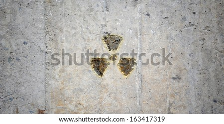 Grey wall with radioactivity symbol. Background image - stock photo