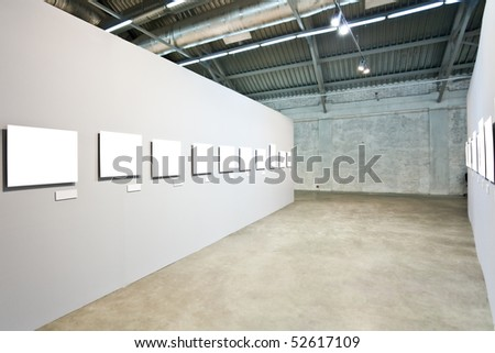 Grey walls with many empty frames - stock photo