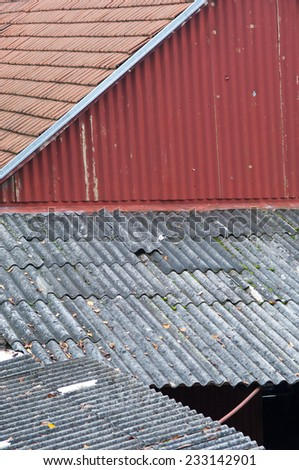 Grey waved asbestos roof. - stock photo