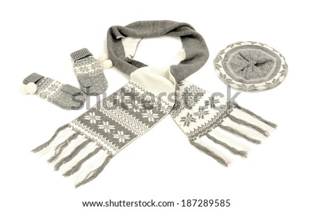Grey winter accessories isolated on white background. Wool scarf, mittens and hat nicely arranged.  - stock photo