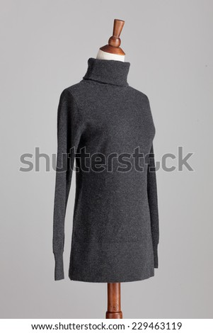 grey woman cashmere sweater with wood model on grey isolated