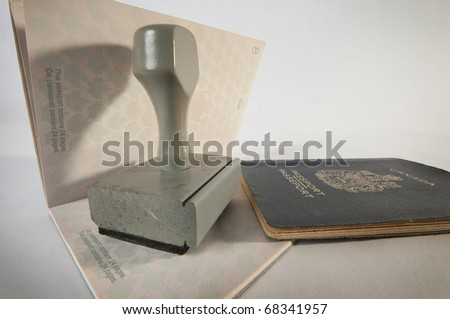 Grey wooden Rubber Stamp  on canadian passport - stock photo