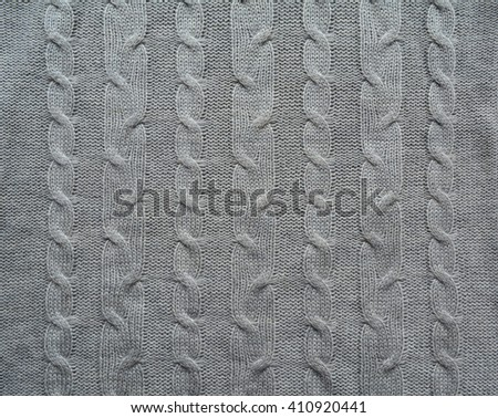 Grey wool knitting.  Textile background. Old knit. Handmade knitting - stock photo