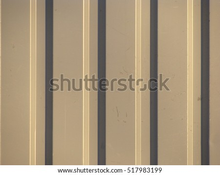Grey yellow color painted corrugated iron sheet close up for background.