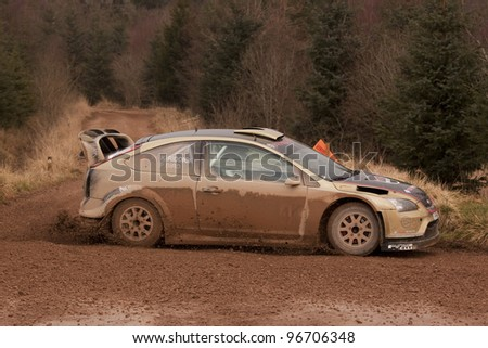GREYSTOKE, ENGLAND - MARCH 3: Paul Bird and Kirsty Riddick drive their Ford Focus WRC to second place in the 2012 Malcolm Wilson Rally on March 3, 2012 in Greystoke Forest, England.