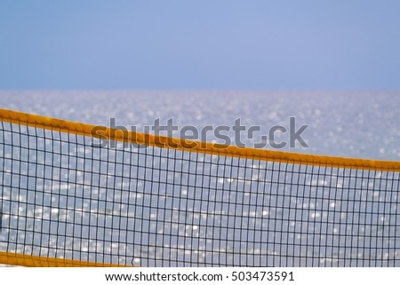 grid for beach volleyball closeup on an indistinct background of the sea and the horizon