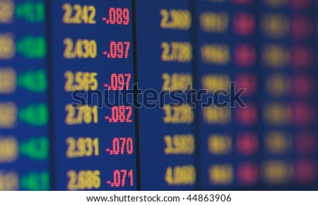 Grid of financial data on a computer monitor showing reducing yields - stock photo