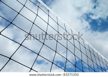 Grid volleyball against the cloudy sky - stock photo
