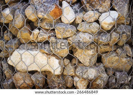 Grid with small stones of granite, background - stock photo