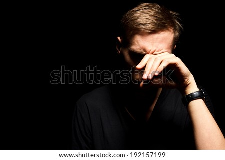 Grief.Man closed face, negative emotions cry or grief - stock photo