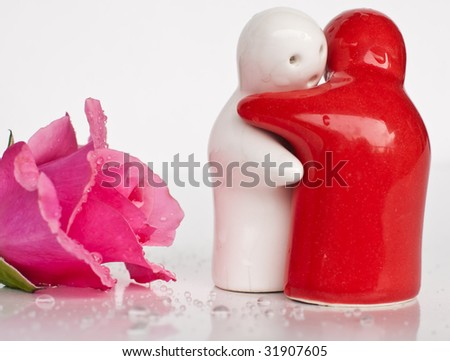 Grievous farewell, two ceramic figures and a rose - stock photo
