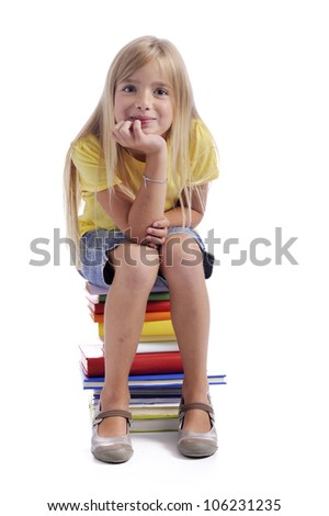 Gril seated on a stack of books. Isolated on white background - stock photo