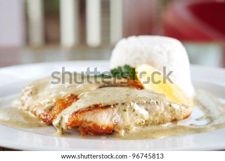 griled chicken breasts in pesto souse - stock photo