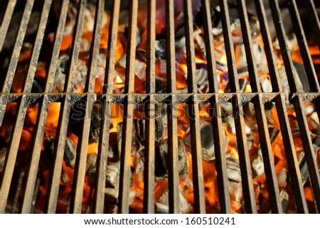 Grill and glowing Charcoal in BBQ grill. You can see more BBQ Grill, Grilled food, flames and fire on my page. Good luck in you art work! - stock photo