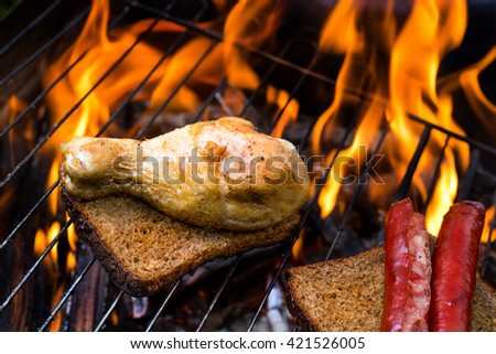 Grill concept. bread with grilled chicken and sausage on bbq