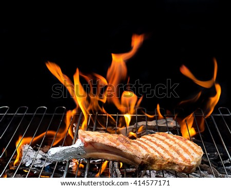 grill concept with flame.  steak on the grill with flames. barbecue - stock photo