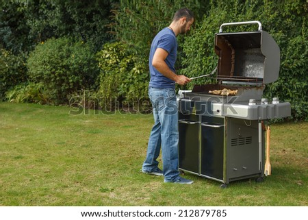 Grill cooking out in the backyard  - stock photo