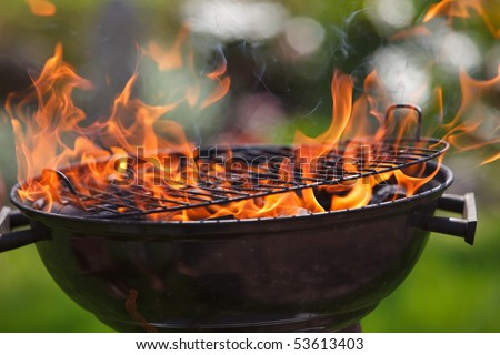 Grill in fames close-up - stock photo