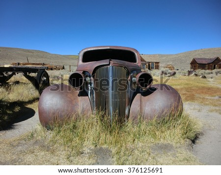Grill of rusty old car in ghost town of Bodie, California - landscape color photo - stock photo