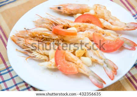 Grill shrimps  with garlic and tomato - stock photo